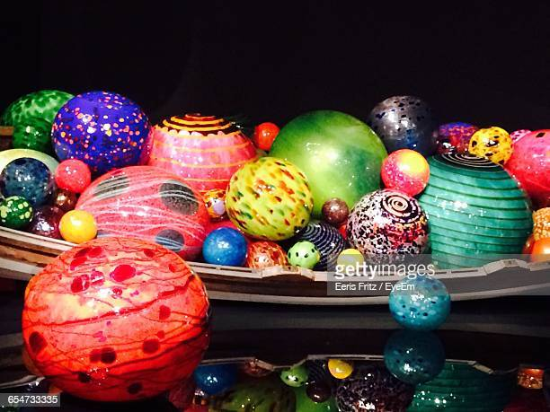 Close-Up Of Multi Colored Balls In Plate On Glass Table