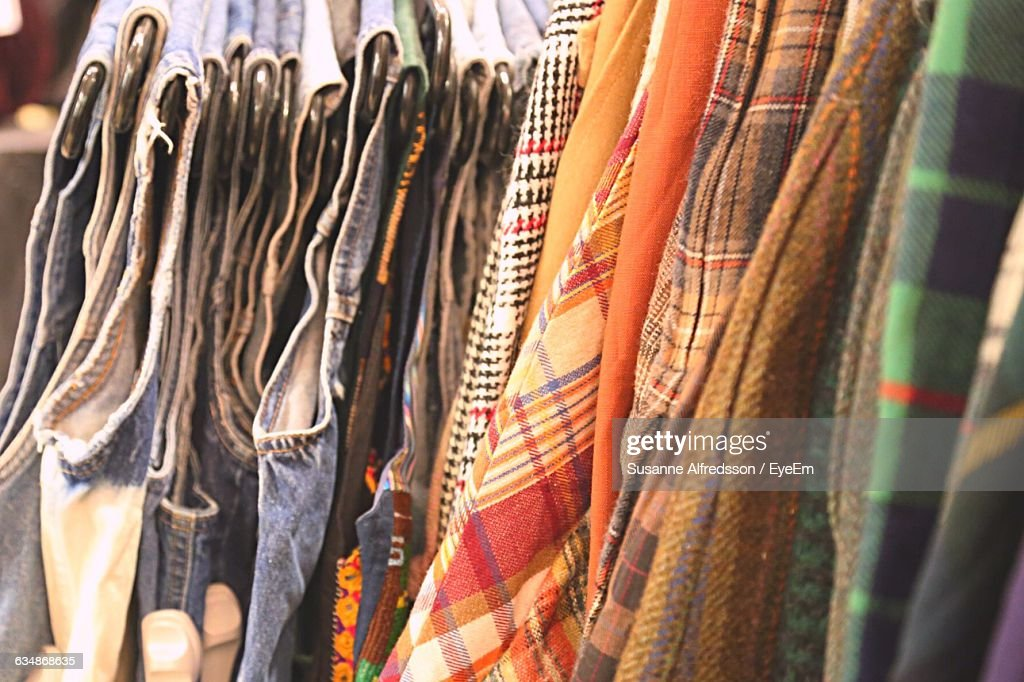 closeup of multi colored clothes rack at shop stock photo getty images. Black Bedroom Furniture Sets. Home Design Ideas