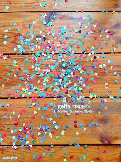 Close-Up Of Multi Colored Confetti On Wooden Planks
