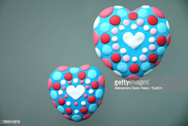 Close-Up Of Multi Colored Heart Shape Candies Over Gray Background