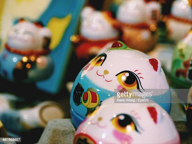Close-Up Of Multi Colored Maneki-Neko Figurines