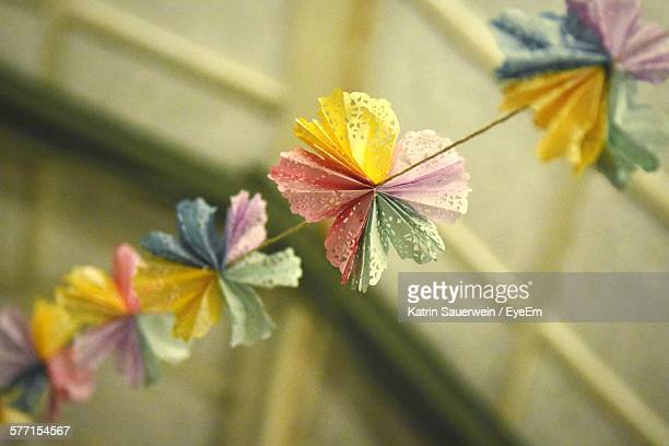 Close-Up Of Multi Colored Paper Flowers Decoration