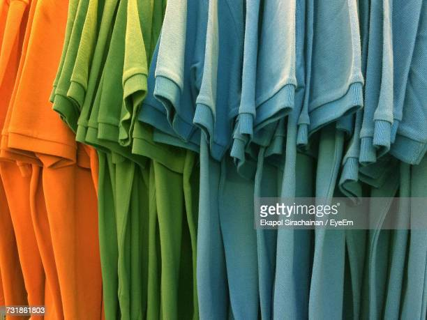 Close-Up Of Multi Colored T-Shirts Hanging For Sale