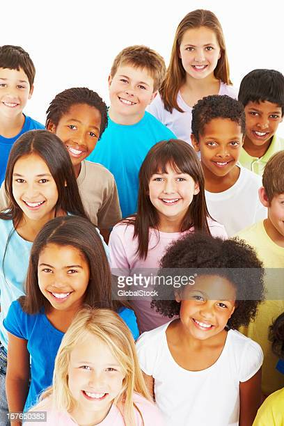 Close-up of multi ethnic kids smiling against white