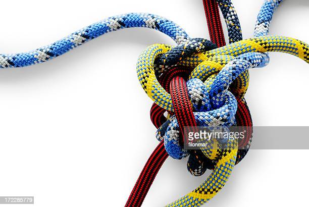 Close-up of multicolored Gordian knot on white background