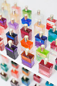 Close-up of multicolored scented perfume bottles in spa