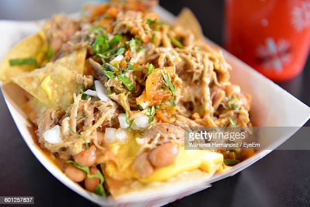 Close-Up Of Nachos With Meat Served On Table