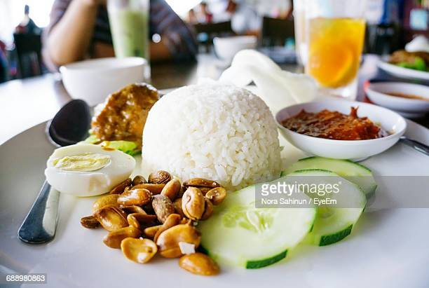 Close-Up Of Nasi Lemak Served In Plate On Table At Restaurant