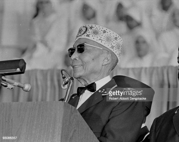 Closeup of Nation of Islam leader Elijah Muhammad as he speaks to an audience on Saviour's Day at the General Richard Jones Armory Chicago Illinois...