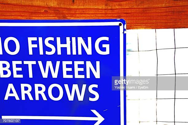 Close-Up Of No Fishing Sign On Fence