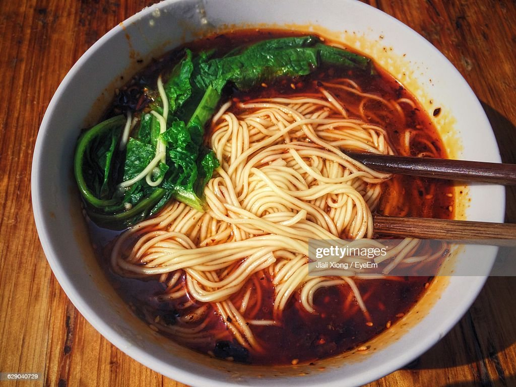 Close-Up Of Noodles Soup Served On Table