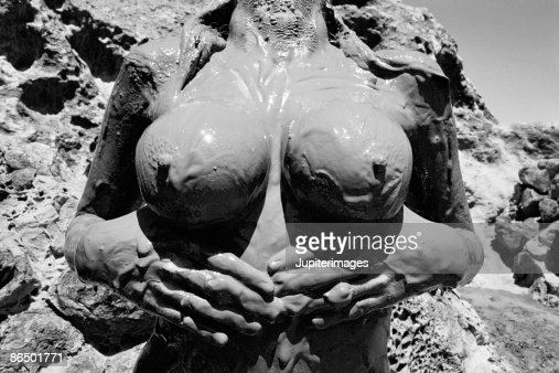 Nude females covered in dirt