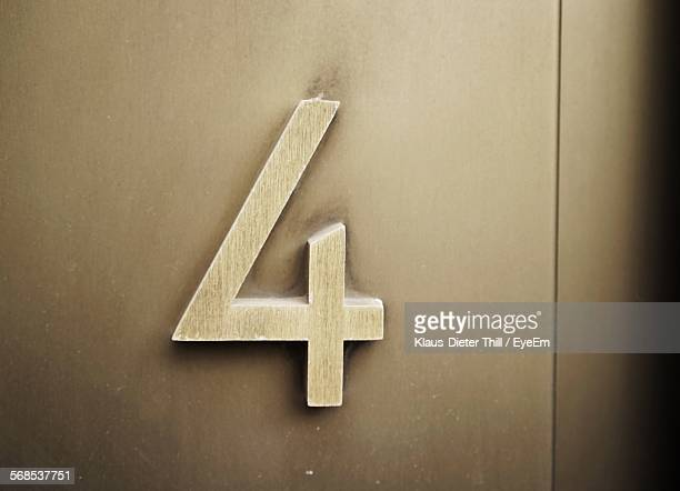 Close-Up Of Number On Closed Wooden Door