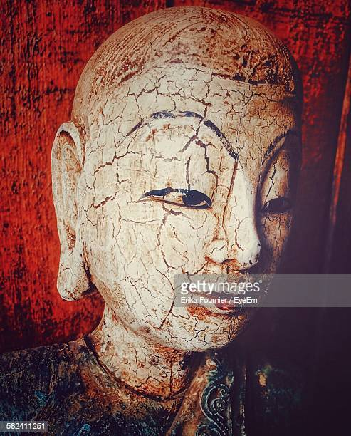 Close-Up Of Old Buddha Painting On Wall