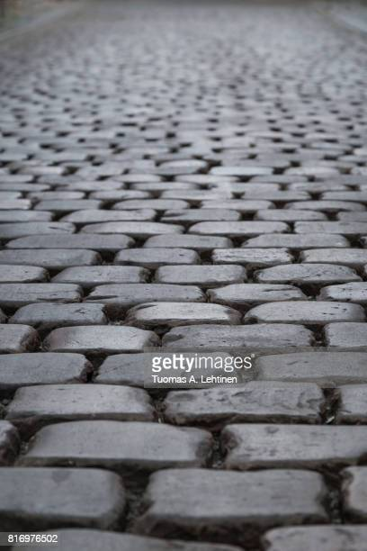 Close-up of old paving stone road at the Old Town in Prague, Czech Republic.