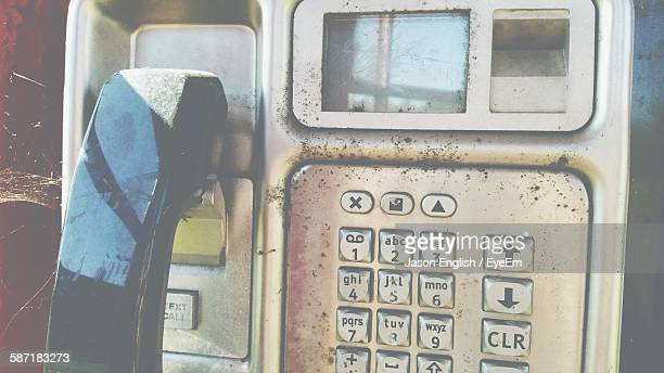 Close-Up Of Old Telephone In Booth