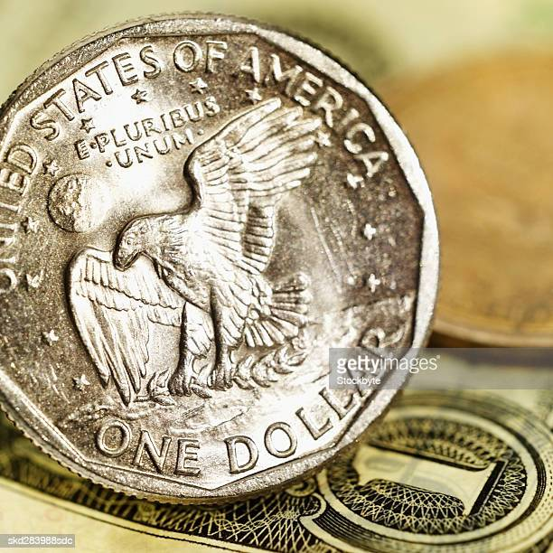 Close-up of one American dollar bill and one dollar coin