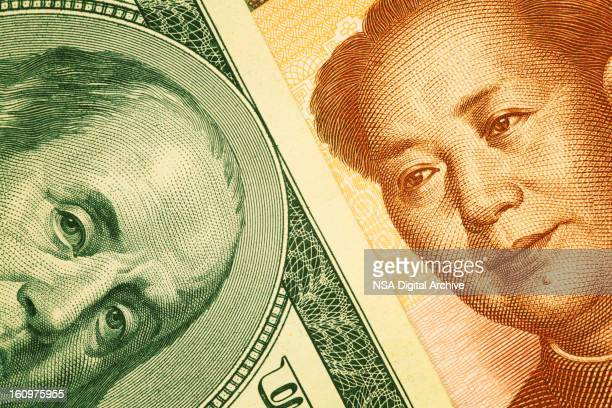 Close-up of One Hundred US Dollar and Chinese Yuan Note