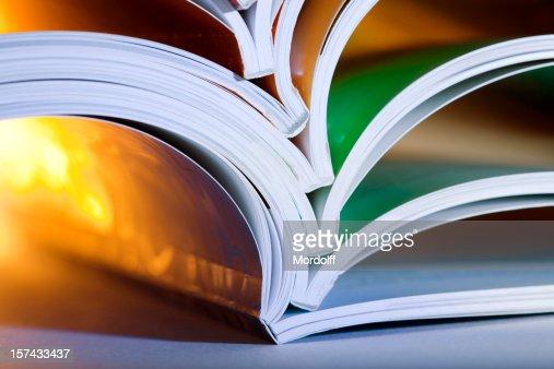 Close-up of opened magazines