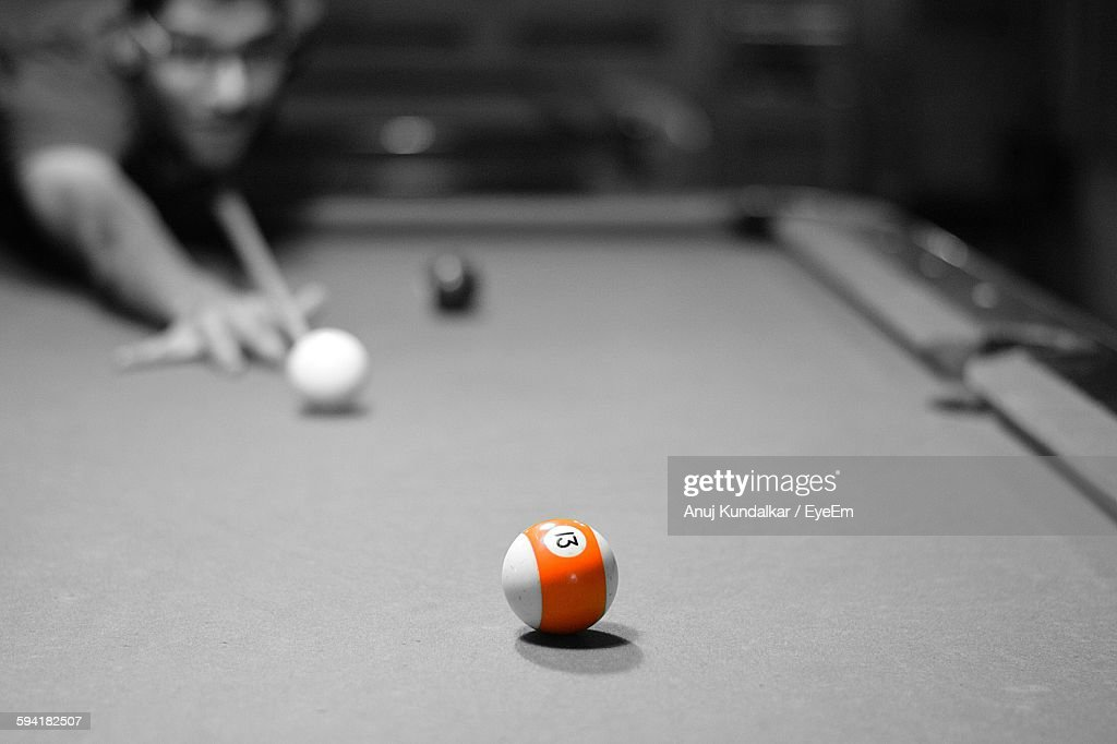 Close-Up Of Orange Ball On Pool Table