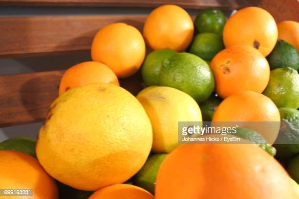 Close-Up Of Oranges And Lemons In Wooden Crate