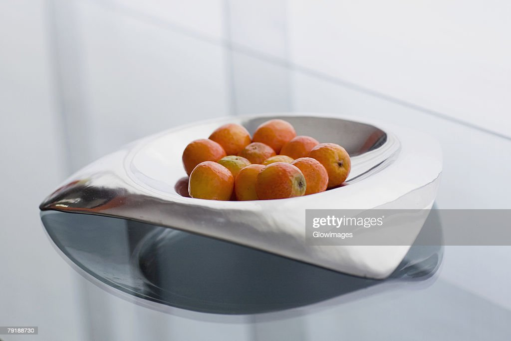 Close-up of oranges in a bowl : Stock Photo