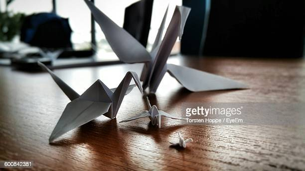Close-Up Of Origami Cranes On Wooden Table