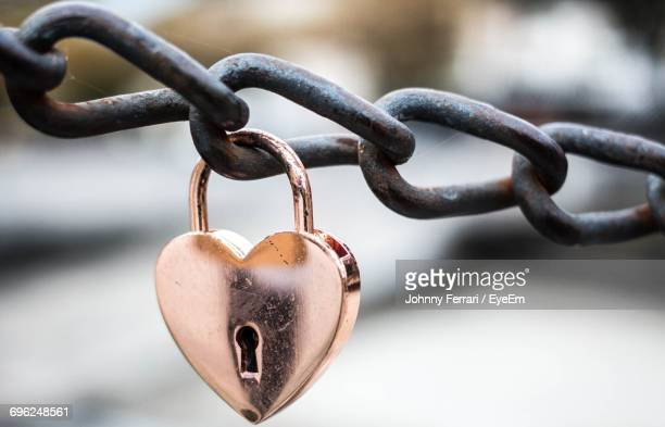Close-Up Of Padlock On Heart Shape Chain