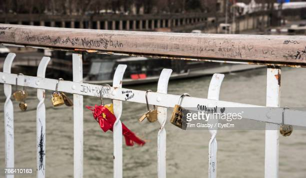 Close-Up Of Padlocks Hanging On Railing