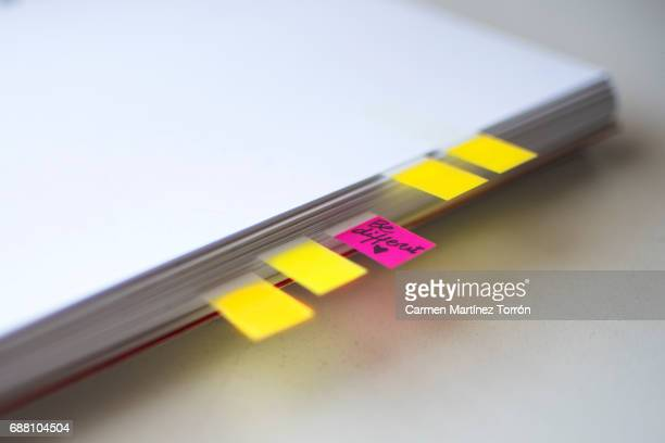Close-Up Of Page Markers and Bookmarks in a notebook