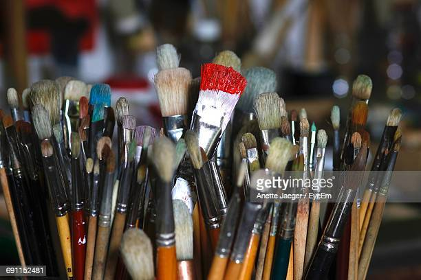 Close-Up Of Paint Brushes At Table