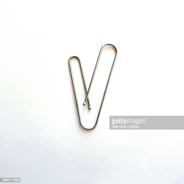 Close-Up Of Paper Clip On White Background