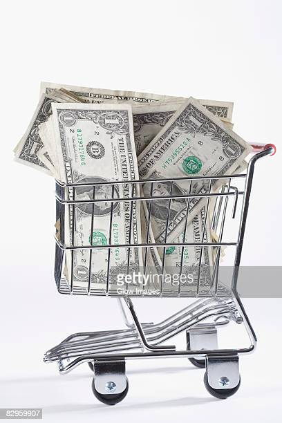 Close-up of paper currency in a shopping cart