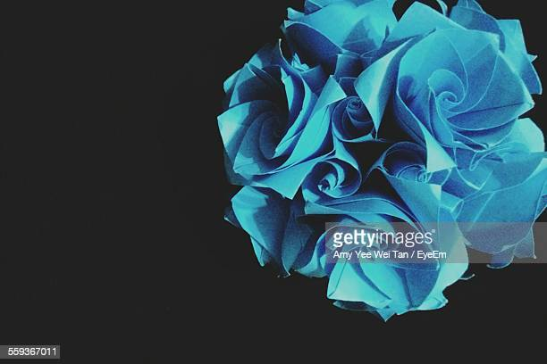Close-Up Of Paper Flower Against Black Background