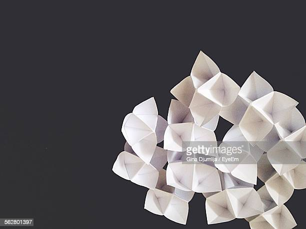 Close-Up Of Paper Flowers Against Black Background