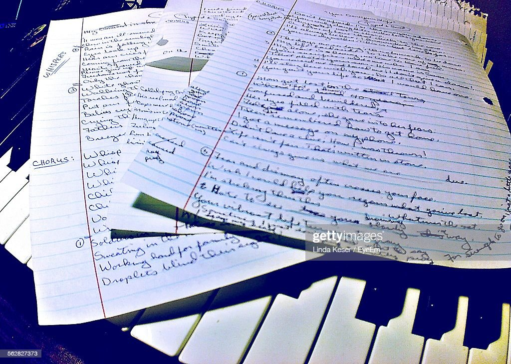 Close-Up Of Papers On Piano Keys