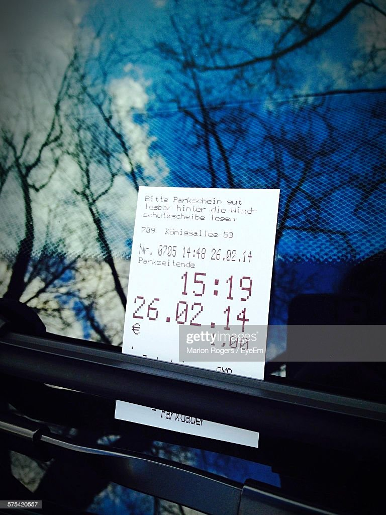 Close-Up Of Parking Ticket On Car : Stock Photo