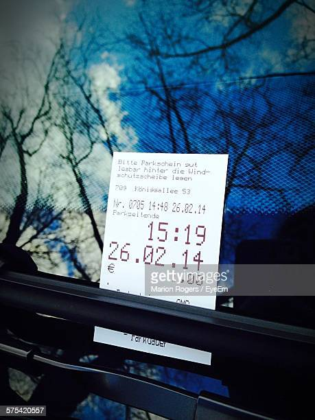 Close-Up Of Parking Ticket On Car