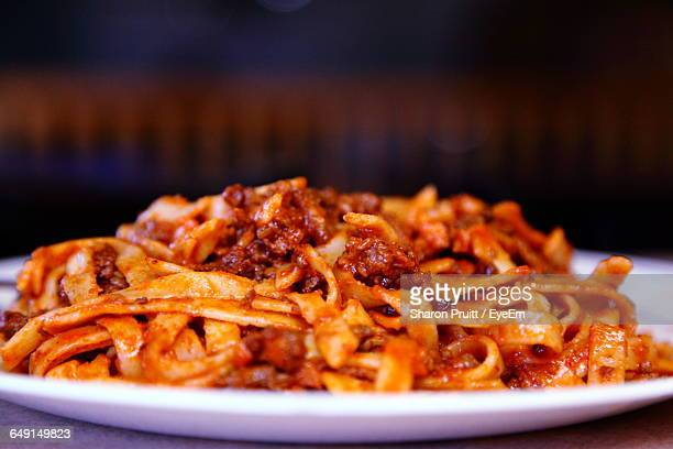 Close-Up Of Pasta With Bolognese Sauce Served In Plate