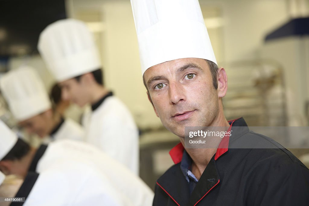 Closeup of pastry chef looking at camera : Stock Photo