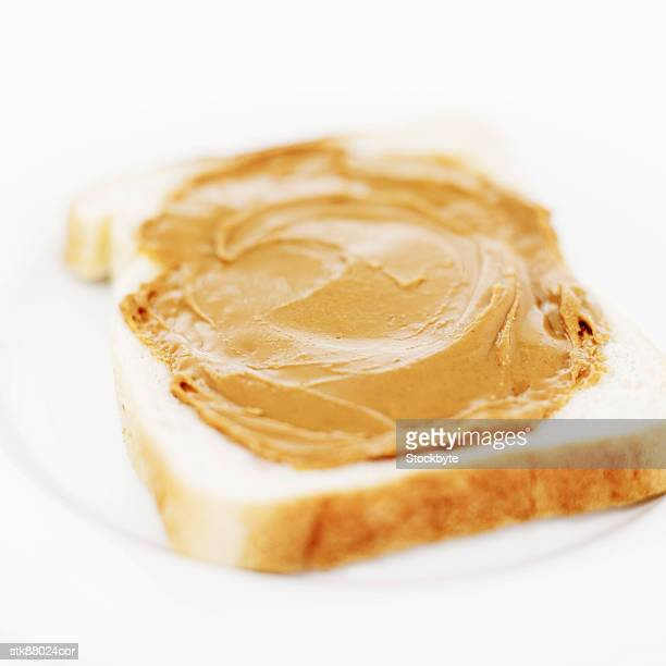 close-up of peanut butter spread on a slice of white bread