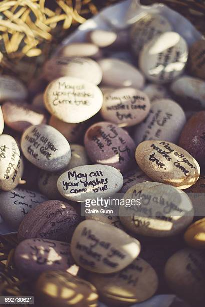 Close-up of pebbles in a basket with sayings hand written on them, Western Cape, South Africa.