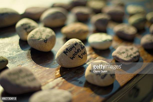 Close-up of pebbles on a table with sayings hand written on them, Western Cape, South Africa.