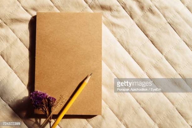 Close-Up Of Pencil And Notebook