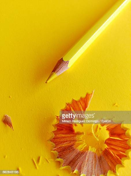 Close-Up Of Pencil Shavings With Yellow Pencil