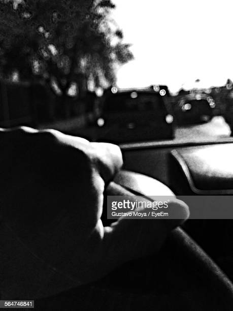 Close-Up Of Person Hand Driving Car