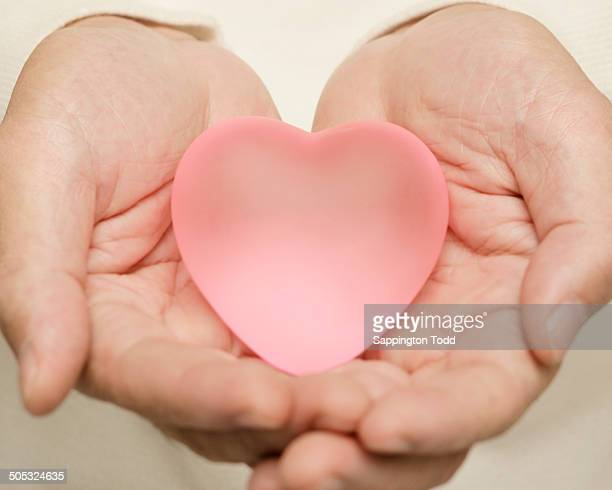 Close-up Of Person Holding Heart
