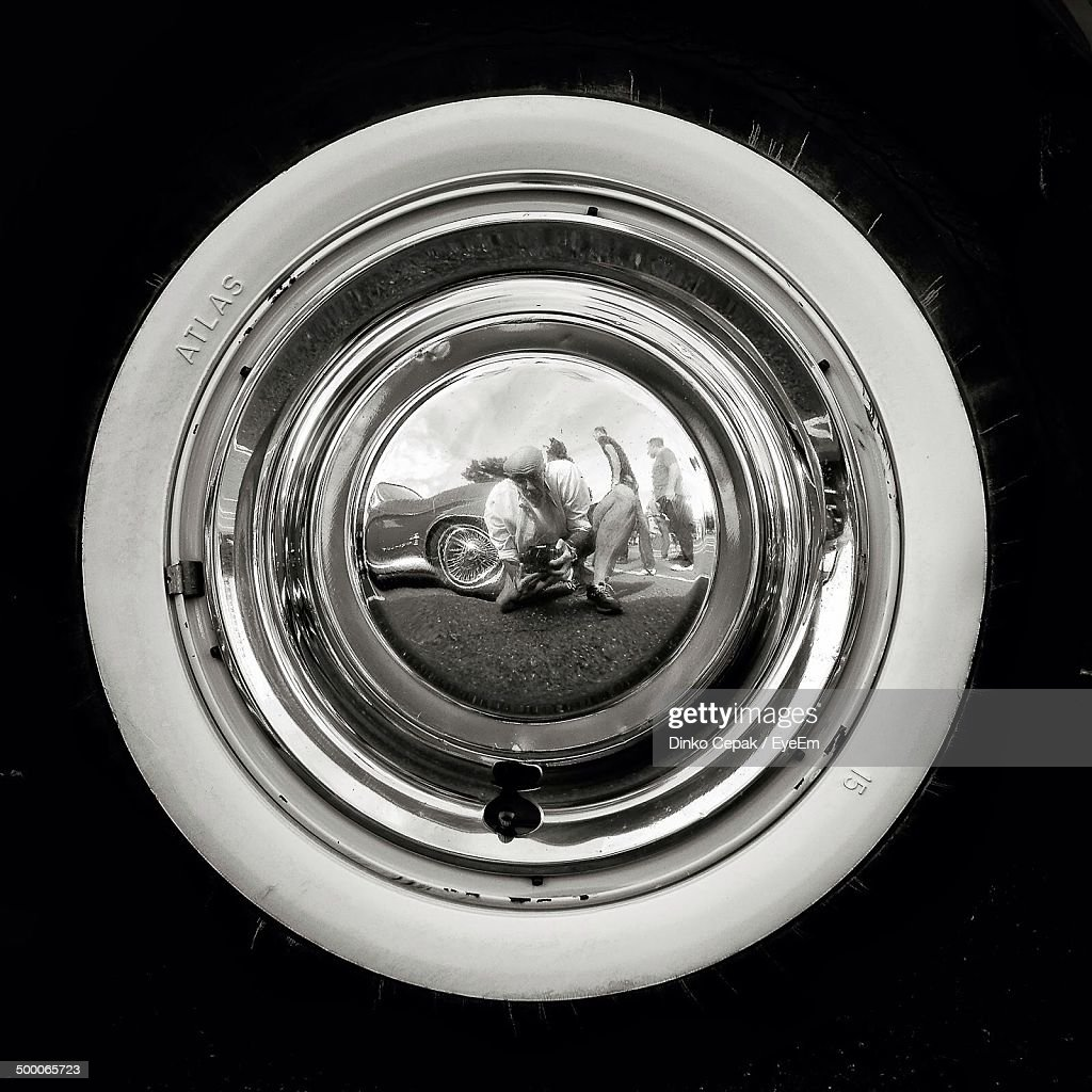 whitewall tire rf closeup of catches reflection of himself in hubcap