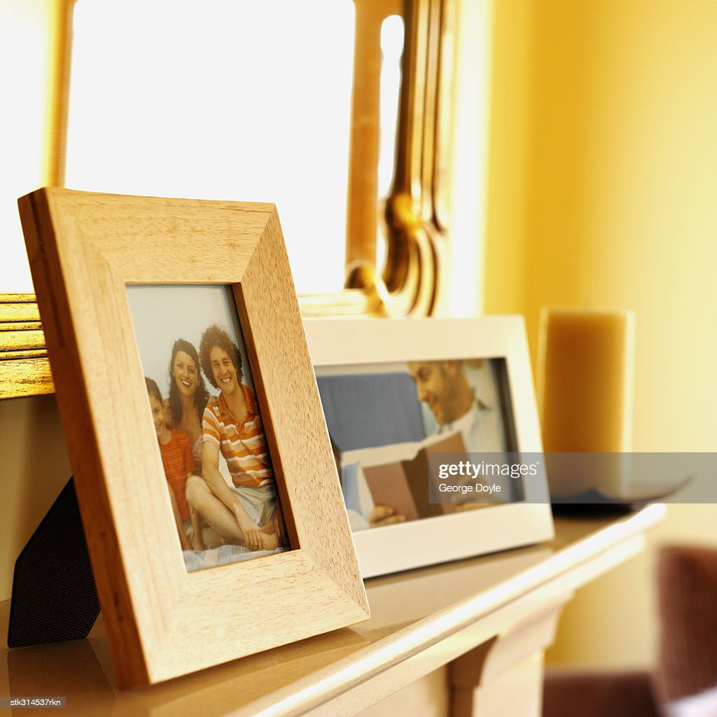 close-up of picture frames on a mantelpiece : Stock Photo
