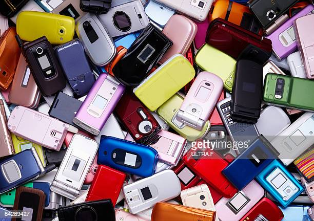 closeup of pile of old mobile phones